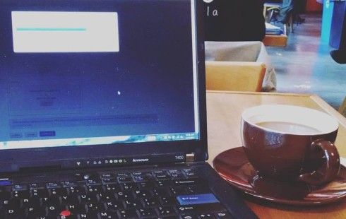 laptop computer loading printing coffee